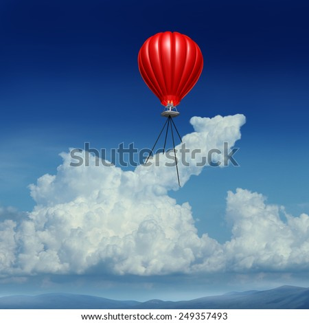 Aim high business success concept as a red hot air balloon lifting up a cumulus cloud shaped as an arrow metaphor for acheivemrent planning andstrategy. - stock photo