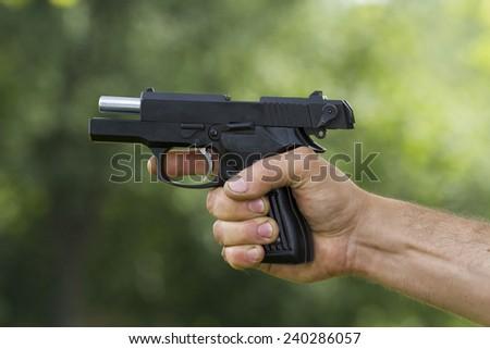 Aiming with handgun - stock photo