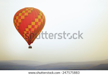 Air balloon flying in the sky. Horizontal photo - stock photo