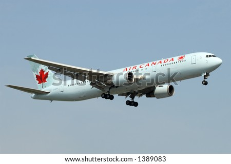 Air Canada aircraft coming in for a landing at Toronto Pearson Airport. - stock photo