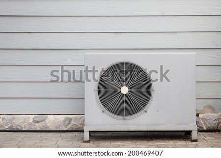 air compressor is outside the office building - stock photo