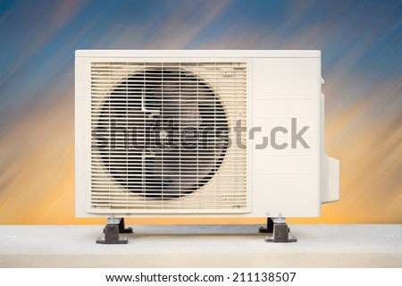 Air compressor with sky background. - stock photo