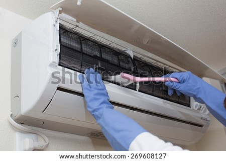 air conditioner cleaning - stock photo