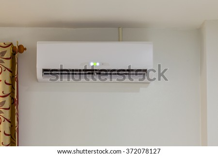 air conditioner install on wall for condo or meeting room, power on - stock photo