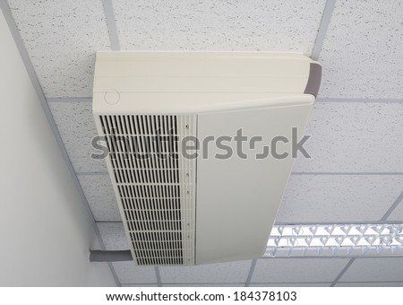 Air conditioner machine fixing with ceiling. - stock photo
