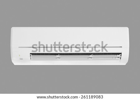 air conditioner machine isolated on gray background - stock photo