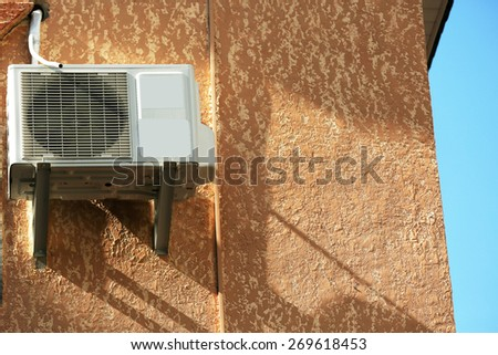 Air conditioner on wall of building, outdoors - stock photo