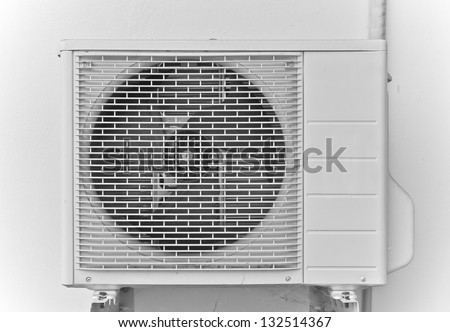 Air conditioner on white wall - stock photo