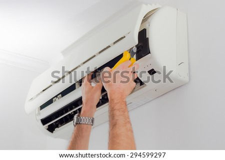 Air conditioning filter cleaning - stock photo