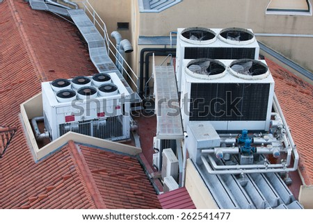 Air conditioning systems on a building roof. - stock photo