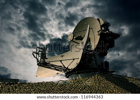 Air defence radar over dramatic night sky. - stock photo