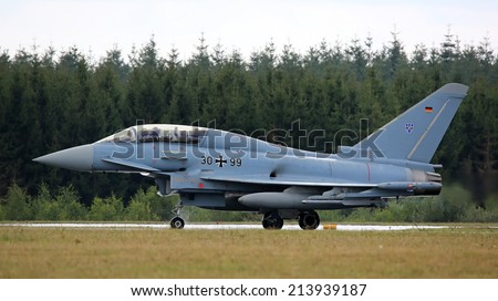 Air Force Base LAAGE, GERMANY - AUGUST 23: Eurofighter training jet after flight demonstration on 23 August, 2014 during the German Air Force Open Day at Tactical Air Force Wing 73 Steinhoff, Germany - stock photo