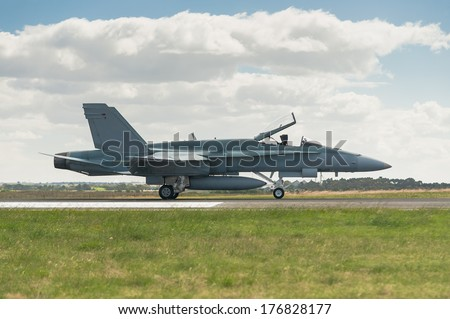 Air Force jet landing on runway - stock photo
