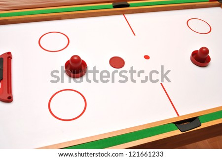 Air Hockey game board and pieces - stock photo