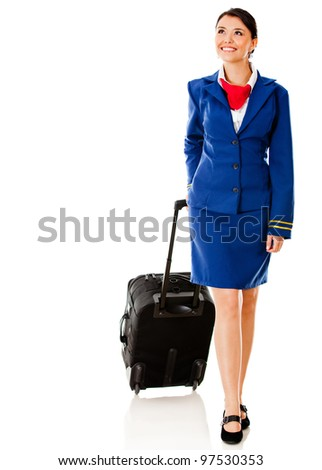 Air hostess walking with her bag - isolated over a white background - stock photo