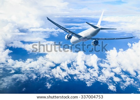 air plane flying against blue sky - stock photo