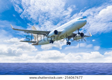 air plane flying on the sea - stock photo