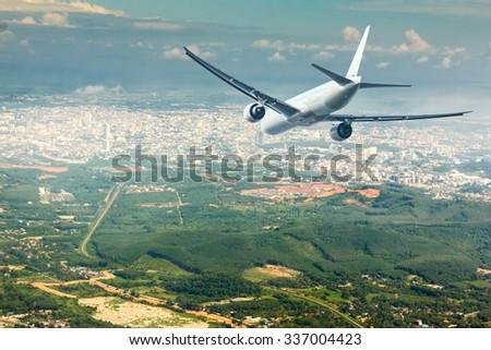 air plane landing to city - stock photo