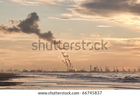 Air Pollution of a Coal Fulled Power Plant at Sunset - stock photo