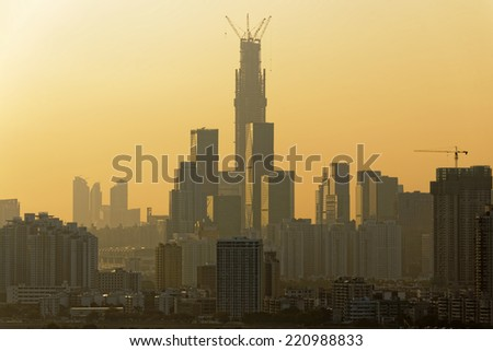 Air pollution scenic in countryside with building and yellow smoke in hong kong city at sunset - stock photo