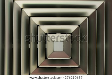 Air vent installed on the white ceiling - stock photo