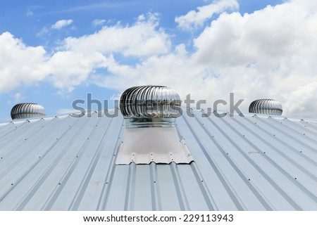 air ventilator on the roof of factory. - stock photo