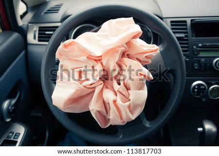 Airbag explodes on steering wheel - stock photo