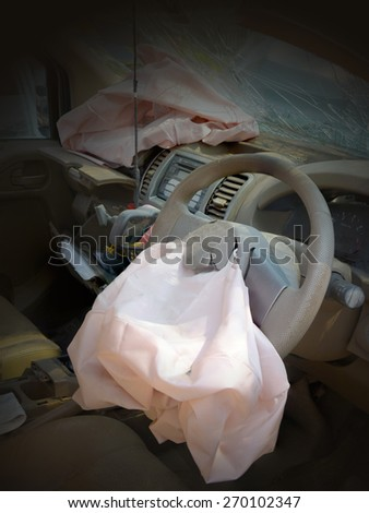 Airbag worked safety driver and cracked after the collision of a car. - stock photo