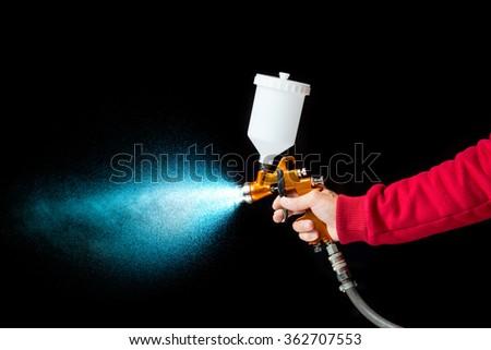 airbrush paint sprayer isolated on black - stock photo