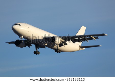 Airbus A300 civil cargo airplane landing in airport. - stock photo