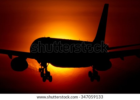 Airbus A330 passenger airplane crossing the sun. - stock photo