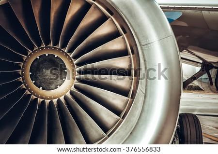 Aircraft engine close-up. Color tone tuned photo - stock photo
