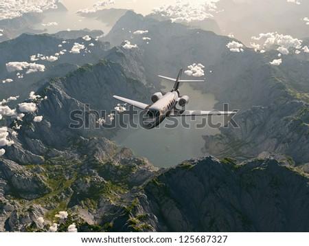 aircraft flies over a mountain range - stock photo
