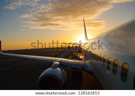 aircraft in airaircraft in airport at sunsetport at sunset - stock photo