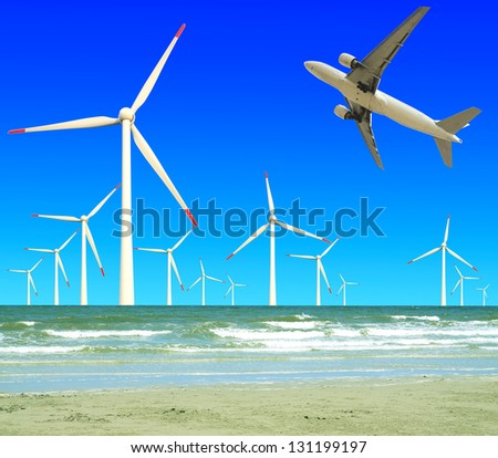 Aircraft is flying in eco power of wind turbines in the sea skyline at concept - stock photo