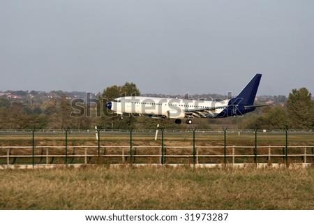 Aircraft landing on the runway - stock photo