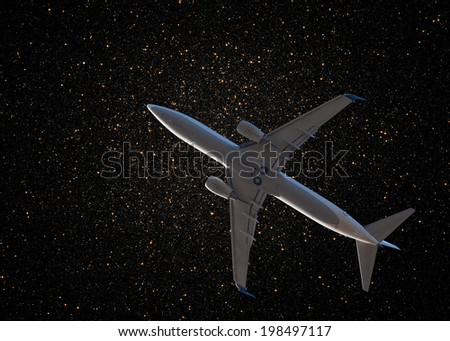 """aircraft on night sky """"Elements of this image furnished by NASA """" (stars) - stock photo"""