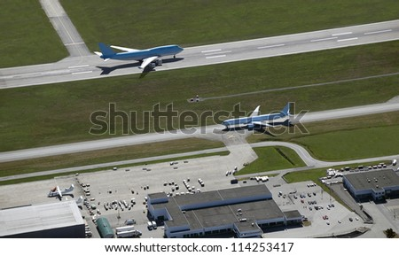 Aircraft on the runway before departure - stock photo