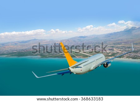 aircraft over the city near airport - stock photo