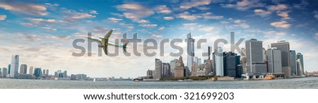 Aircraft overflying New York City skyline. - stock photo