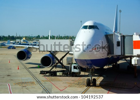 Aircraft parked in the airport - stock photo
