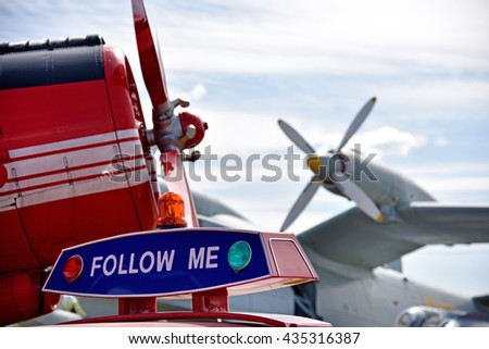 """Aircraft propellers of planes in the airport and the car with the words """"Follow me"""" (Children's Dreams - concept) - stock photo"""