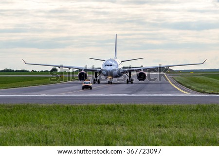 Aircraft taxiing for follow me car at the airport - stock photo