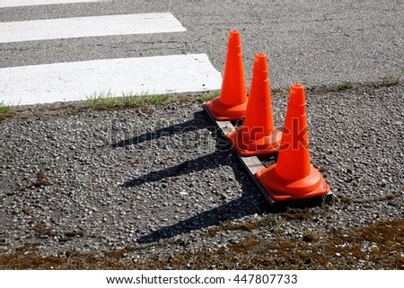 Aircraft - Three red Traffic cone with a shadow from the setting sun. - stock photo
