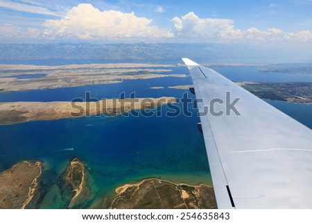 Aircraft wing on the clouds,flying background Croatia - stock photo