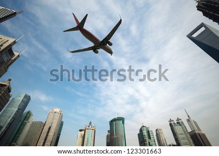 aircraft with shanghai skyline of the lujiazui financial center - stock photo