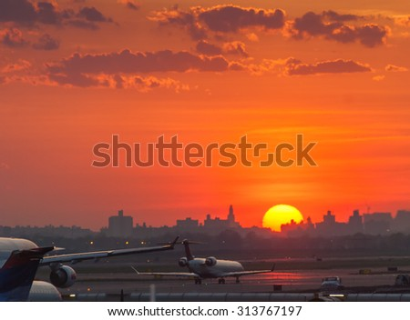 Aircrafts passenger plane ready to take off from runways against beautiful dusky sky. Use for air transport ,journey and traveling industry business. - stock photo