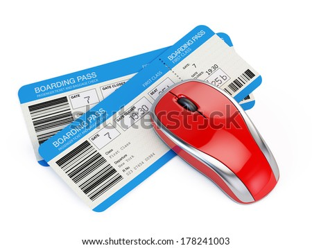 Airline tickets and computer mouse - stock photo