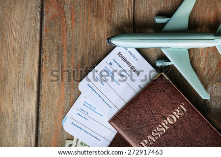Airline tickets and documents on wooden table, top view - stock photo