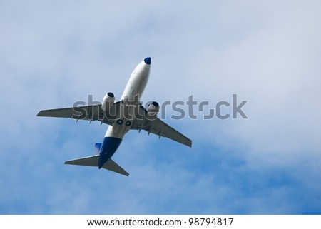 Airliner against cloudy sky - stock photo